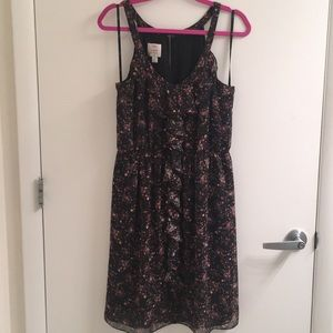 Floral dress with ruffle detail and cinched waist
